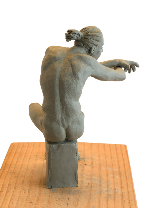 Seated Man Clay Sculpture